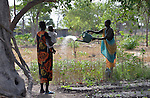 A woman waters the crops at the Multi Agricultural Jesuit Institute of Sudan (MAJIS), an agricultural school located outside Rumbek, South Sudan.