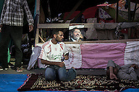 In this Wednesday, Jul. 10, 2013 photo, supporters of the ousted president Mohammed Morsi observe fasting in the streets nearby Al-Rabba Alawya mosque during the first day of the holy month of Ramadan in Cairo, Egypt. (Photo/Narciso Contreras).