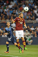 Sporting Park, Kansas City, Kansas, July 31 2013:<br /> Federico Balzaretti (42) defender AS Roma heads the ball away.<br /> MLS All-Stars were defeated 3-1 by AS Roma at Sporting Park, Kansas City, KS in the 2013 AT &amp; T All-Star game.