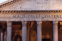 Detail of pediment and entablature showing Roman inscriptions of the portico of the Pantheon, ancient temple in Rome dating from 125 AD by Emperor Hadrian (reconstruction), later converted into the church of Santa Maria ad Martyres, Rome, Italy. Picture by Manuel Cohen