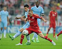 FUSSBALL   CHAMPIONS LEAGUE   SAISON 2011/2012     27.09.2011 FC Bayern Muenchen - Manchester City Bastian Schweinsteiger (re, FC Bayern Muenchen) gegen Sergio Agueero (li, Manchester City)
