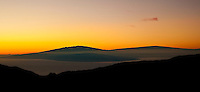 A very rare dawn view of the outline of Mauna Kea and the coast of the Big Island beyond the 'Alenuihaha Channel from the summit of Haleakala in Haleakala National Park, Maui.