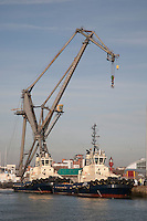 Crane and Tugs in Southampton Dock, England, UK
