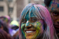 A woman looks on camera during Holi Hai Celebration in New York , March 31, 2013. The festival has many purposes. First and foremost, it celebrates the beginning of the new season, spring.VIEWpress /Kena Betancur