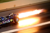 Jul 23, 2016; Morrison, CO, USA; Detailed view of flame coming from the engine of the car of NHRA jet dragster driver Tony Franco Jr during qualifying for the Mile High Nationals at Bandimere Speedway. Mandatory Credit: Mark J. Rebilas-USA TODAY Sports