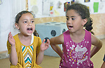 Children sing loudly during an activity at the Youth Empowerment Center in Beit Hanoun, Gaza. The program is supported by Caritas and DanChurchAid, a member of the ACT Alliance, and is designed to help children better cope with the trauma they experienced during the 2014 war.<br /> <br /> In the wake of that war between the government of Gaza and the government of Israel, ACT Alliance members are supporting health care, vocational training, rehabilitation of housing and water systems, psycho-social care, and other humanitarian actions throughout the besieged Palestinian territory.