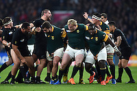 The South Africa front row of Frans Malherbe, Adriaan Strauss and Trevor Nyakane in action at a scrum. Rugby World Cup Semi Final between South Africa and New Zealand on October 24, 2015 at Twickenham Stadium in London, England. Photo by: Patrick Khachfe / Onside Images