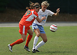 24 September 2006: Miami's Jessica Wyble (19) and UNC's Kristi Eveland (32). The University of North Carolina Tarheels defeated the University of Miami Hurricanes 6-1 at Fetzer Field in Chapel Hill, North Carolina in an NCAA Division I women's soccer game.