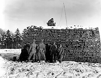 The pathfinder unit of the 101st Airborne Div., dropped by parachute, sets up radar equipment near Bastogne, Belgium.  It is their job to guide planes with medical supplies and ammunition to the division, besieged by the Germans.  December 23, 1944.  T5c. Krochka. (Army)<br /> NARA FILE #:  111-SC-222396<br /> WAR &amp; CONFLICT BOOK #:  1072