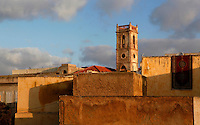 High angle view of the bell tower of the church of St Anthony of Padua, late 19th century, El Jadida, Morocco, seen across the rooftops. The Spanish convent church is an example of religious co-habitation in this Atlantic port city. El Jadida, formerly Mazagan, was occuped by the Portuguese from 1502 to 1769. Picture by Manuel Cohen