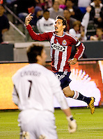 Chivas USA midfielder Sacha Kljestan (16) scores a goal off San Jose Earthquakes goalkeeper Joe Cannon (1) and begins to celebrate. CD Chivas USA and San Jose Earthquakes are tied 1-1 at the half at Home Depot Center stadium in Carson, California on Saturday April 24, 2010.  .