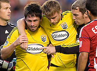 Columbus Crew midfielder Eddie Gaven (12) is helped off the field after being hit in the head by the knee Chivas USA goalkeeper Dan Kennedy. CD Chivas USA defeated the Columbus Crew 3-1 at Home Depot Center stadium in Carson, California on Saturday July 31, 2010.