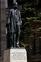 Toronto (ON) CANADA - April 24 2008 File Photo<br /> Statue of John Sandfield - MacDonald, Prime-Minister of Ontario (1876-1871) in front of the Legislative Assembly of Ontario in<br />  Queens Park ( in the Downtown area of Toronto)<br /> <br /> <br />  Opened in 1860 by Edward, Prince of Wales, it was named in honour of Queen Victoria. The park is the site of the Ontario Legislature, which houses the Legislative Assembly of Ontario, and so the phrase Queen's Park is also frequently used to refer to the Government of Ontario.