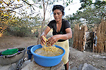 Adriana Alvarez washes corn in preparation for grinding it to make tortillas in La Pacaira, a small village in northwestern Nicaragua.