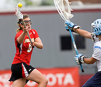 Laura Merrifield (9) of Maryland takes a shot during the ACC women's lacrosse tournament finals in College Park, MD.  Maryland defeated North Carolina, 10-5.
