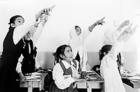 Iraq. Basrah. Al Fao neighbourhood. Primary school for girls. Pupils ask their teacher to choose them by raising their arms up to answer mathematics questions. Basra ( in arabic Al Barah) is the capital of Basra Governorate in southern Iraq. © 2004 Didier Ruef
