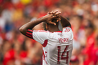 Thierry Henry (14) of the New York Red Bulls reacts to a missed scoring opportunity. The New York Red Bulls defeated the Houston Dynamo 2-0 during a Major League Soccer (MLS) match at Red Bull Arena in Harrison, NJ, on June 30, 2013.