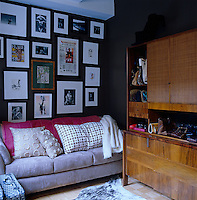 The walls of the dressing room are covered with framed photographs and memorabilia