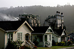 The power plant looms behind homes in the town of Scotia in Northern California is a company town owned by the Pacific Lumber Company (PALCO), but that will change as the company will begin to sell the town. (Photo by Max Whittaker for The New York Times)<br />