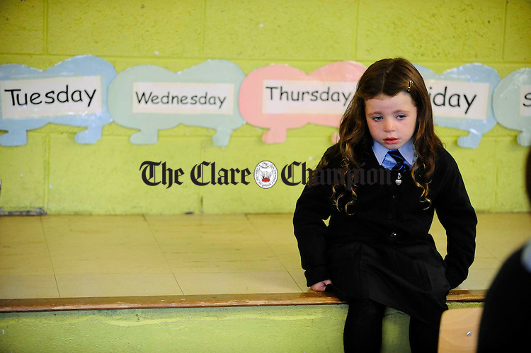 Little Brittany Mc Donagh is a little sad on her first day of School at Scoil Chriost Ri, Cloughleigh, Enis. Photograph by John Kelly.