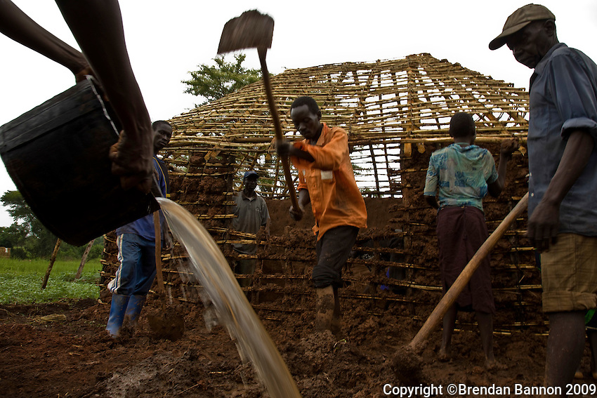 Refugees preparing  traditional shelter in Nyori  camp, South Sudan