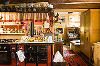 The cosy kitchen is dominated by an impressive stove and opens into a comfortable sitting area