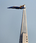 A Navy Blue Angels jets fly near the TransAmerican Pyramid in preparation for Fleet Week in San Francisco, California.