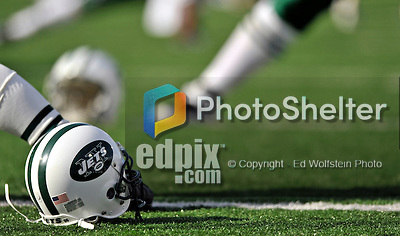 2 November 2008:  A New York Jets' helmet lies on the turf prior to a game against the Buffalo Bills at Ralph Wilson Stadium in Orchard Park, NY. The Jets defeated the Bills 26-17 improving the NY record to 5 and 3 for the season...Mandatory Photo Credit: Ed Wolfstein Photo