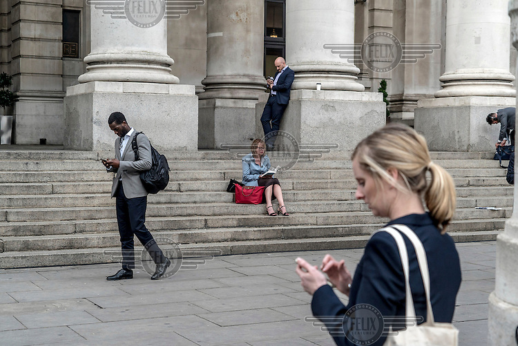 People outside the Bank of England during the rush hour in the City of London on the morning following the EU referendum. The success of the 'leave' (the EU) vote led to immediate financial turmoil as the markets reacted negatively to the result.