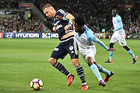 Melbourne, 17 December 2016 - BESART BERISHA (8) of the Victory and BRUCE KAMAU (11) of Melbourne City fight for the ball in the round 11 match of the A-League between Melbourne City and Melbourne Victory at AAMI Park, Melbourne, Australia. Victory won 2-1 (Photo Sydney Low / sydlow.com)