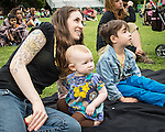 Alice west and her children Fedor and Flora Hess West watch a Wild Life Live show at The Oregon Zoo. © Oregon Zoo / Photo by Carli Davidson