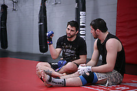 Jackson's/Winkeljohn's: January 16, 2012 UFC Welterweight Carlos Condit talks with a teammate prior to Greg Jackson's grappling class at Jackson's/Winkeljohn's in Albuquerque, NM