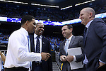 28 December 2016: Former UNC player and current head coach King Rice (left) meets UNC assistant coaches (from left) Hubert Davis, C.B. McGrath, and Brad Frederick. The University of North Carolina Tar Heels hosted the Monmouth University Hawks at the Dean E. Smith Center in Chapel Hill, North Carolina in a 2016-17 NCAA Division I Men's Basketball game. UNC won the game 102-74.