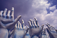 Sculptures of hands. Samba School Parade, Rio de Janeiro Carnival, Brazil. Allegory, faith, popular culture, hands up to heaven.