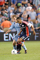Jeremiah White (15) New England holds off Sporting KC defender Seth Sinovic... Sporting Kansas City defeated New England Revolution 3-0 at LIVESTRONG Sporting Park, Kansas City, Kansas.
