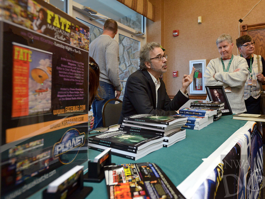 NWA Democrat-Gazette/BEN GOFF @NWABENGOFF<br /> Richard Dolan, a UFO researcher, speaker and author, talks to guests at his table on Saturday April 9, 2016 during the 29th annual Ozark Mountain UFO Conference at the Best Western Inn of the Ozarks in Eureka Springs.