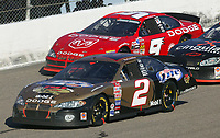 Rusty Wallace (2) leads eventual winner Bill Elliott (9) and Robbie Gordon off of turn 4 during the Pop Secret 400 NASCAR Winston Cup race at Rockingham, NC on Sunday, November 9, 2003. (Photo by Brian Cleary)