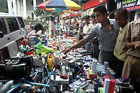 Indian men buying pirated electronic goods on a foot path  in Kolkata, West Bengal,  India  7/18/2007.  Arindam Mukherjee/Landov