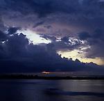 Sky at dusk showing a litle orange on the horizon over the sea. Lautoka, Fiji Islands.
