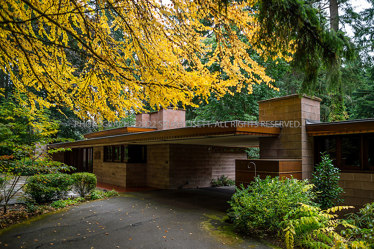 """10/9/2012--Sammamish, WA, USA..VIEW: Exterior showing back of house with main entrance (left) and car port (right)..Architect Frank Lloyd Wright planned his """"Usonian"""" homes to be affordable for middle-class families. The 1,9500 square foot Brandes home is for sale in Sammamish, Washington (30 minutes from Seattle) at $1.39 million. It features three bedrooms, two bathrooms and a small, separate office/study space...The home was built in 1952, and has redwood trim and Wright's original furniture and some garden sculptures by Wright. It's one of only three Frank Lloyd Wright homes near Seattle...©2012 Stuart Isett. All rights reserved."""