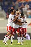 Juan Pablo Angel (9) of the New York Red Bulls celebrates at the final whistle with Mike Petke (12) and Connor Chinn (25). The New York Red Bulls defeated the Houston Dynamo 2-1 during a Major League Soccer (MLS) match at Red Bull Arena in Harrison, NJ, on June 2, 2010.