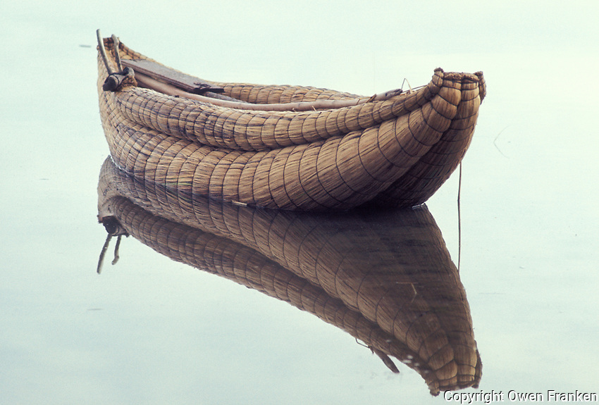 Near Puno, Peru --- Reed Fishing Boat on Lake Titicaca --- Photograph by Owen Franken