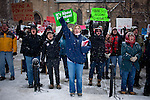 Retired teacher Randi Kluesner, center, protests outside the  Wisconsin State Capitol over a bill that threatens to strip collective bargaining rights in Madison, Wisconsin, February 26, 2011. Crowds swelled Saturday as protests enter their 12th day.