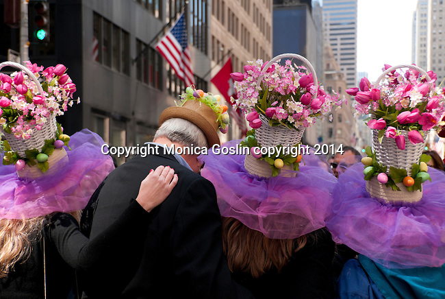 A family poses for photos wearing large baskets filled with flowers on top of their hats for the Easter Parade on Fifth Avenue in New York City