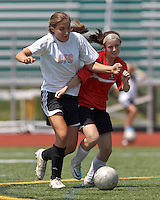 CFC Passion midfielder Jenni Issac (8) and Aztec MA forward Brittany Russo (2) battle for the ball. In a Women's Premier Soccer League (WPSL) match, Aztec MA defeated CFC Passion, 4-0, at North Reading High School Stadium on July 1, 2012.