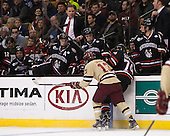 Johnny Gaudreau (BC - 13) hits former teammate Vinny Saponari (NU - 74). - The Boston College Eagles defeated the Northeastern University Huskies 6-3 on Monday, February 11, 2013, at TD Garden in Boston, Massachusetts.