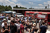 June 6, 2010. Durham, North Carolina.. At the Bull City Street Vendor Rodeo many local food trucks filled the parking lot for awaiting eaters.. The Triangle has seen a recent boom in the number of mobile food trucks selling everything from tacos, to Korean BBQ, to fresh juices.