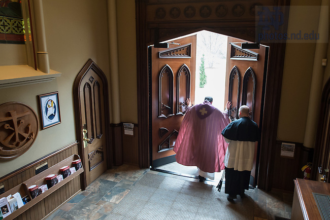 Dec. 13, 2015; Rev. Peter Rocca, C.S.C. opens the front doors of the Basilica of the Sacred Heart as a symbolic opening of the Doors of Mercy. The ceremony, during the 10am Sunday Mass at the Basilica, was in recognition of Pope Francis' announcement of an Extraordinary Jubilee of Mercy. (Photo by Matt Cashore/University of Notre Dame)
