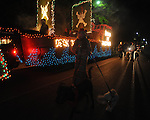 Katherine Kvam walks dogs next to the Crossroads Animal Hospital float in the Christmas parade in Oxford, Miss. on Monday, December 6, 2010.