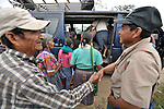 Two friends greet each other while getting on a bus in Victoria 20 de enero, a village of former Guatemalan refugees in Mexico who returned home as a group in 1993, while the country's bloody civil war still raged.
